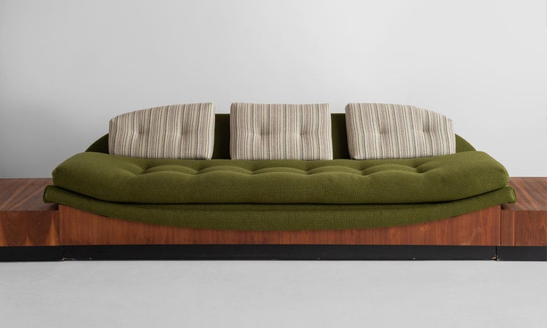 Adrian Pearsall Gondola sofa, circa 1960.  Newly upholstered in Maharam fabric on original walnut veneer base with side tables.