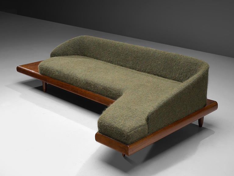 Adrian Pearsall, 'Boomerang' sofa, green wool upholstery, walnut, United States, 1960s  This boomerang sofa has a unique shape with sinuous lines which create a monumental and inviting look. The L-shaped sofa is a great addition to a living area or