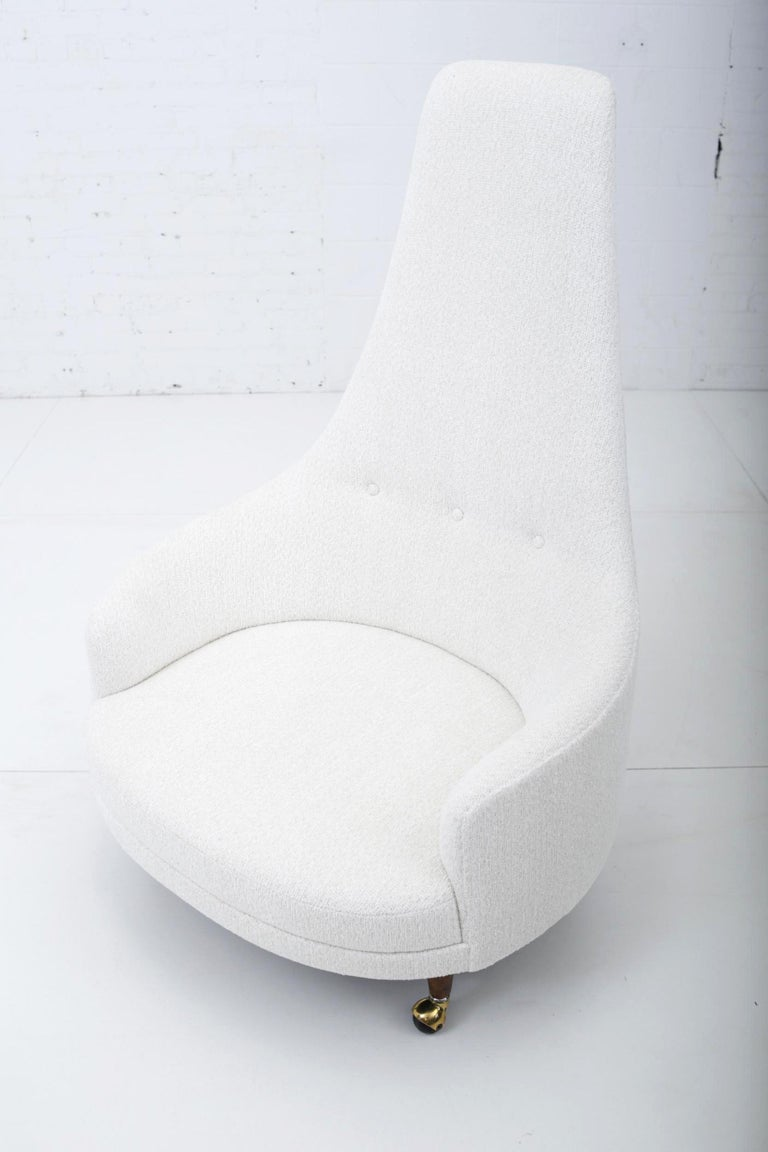 Adrian Pearsall high back lounge chair. Upholstered in white wool weave with walnut legs.