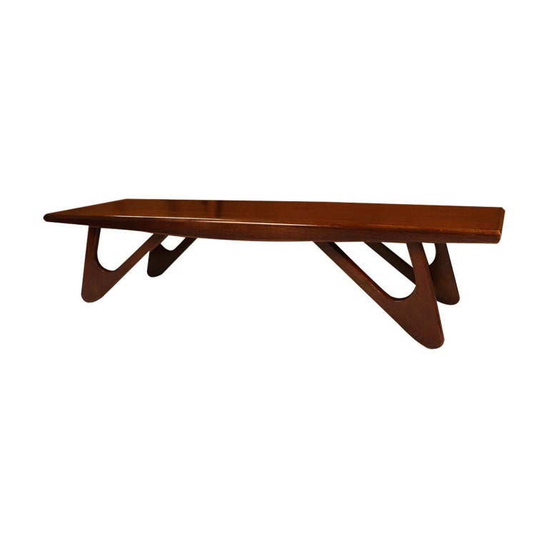 An absolutely stunning, artistic sculptural coffee table designed by Adrian Pearsall for Craft Associates, Wilkes-Barre, PA., the furniture company created by Mr. Pearsall. An exceptional construction and style, this coffee table features a