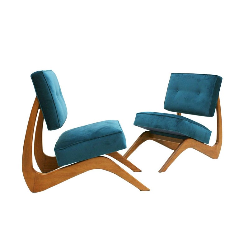 Pair of lounge chairs designed by America designer Adrian Pearsall (born 1925, Trumansburg, New York - died in Pennsylvania 2011) was a talented architect and furniture designer.  The structure of this lounge cocktail-chairs is made of walnut wood