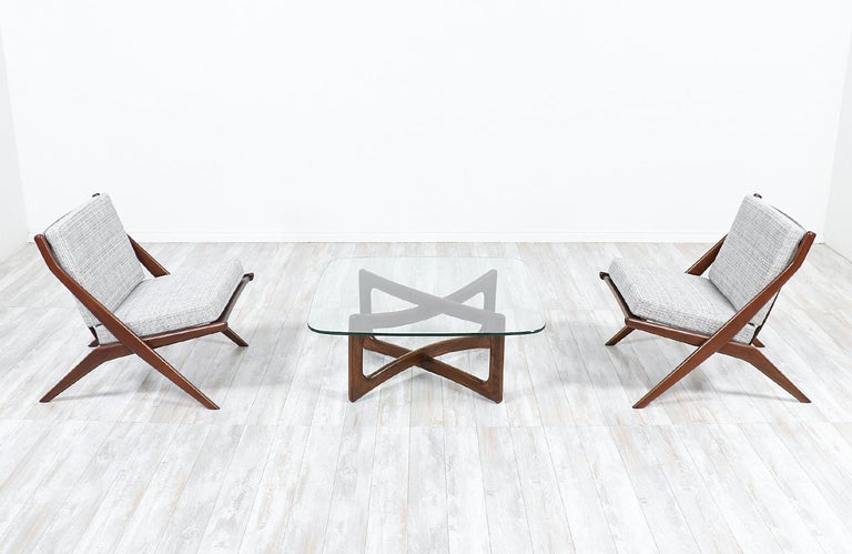 Elegant modern coffee table designed by Adrian Pearsall in the United States for Craft Associates circa 1960s. Like many of Pearsall's designs, the model 2452-T36 features a fun and unique structure with a sculpted walnut wood base and a new custom