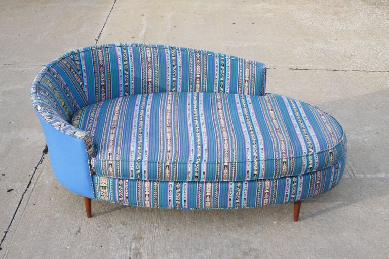 Mid-Century Modern Adrian Pearsall for Craft Associates oval chaise longue or sofa upholstered with Mexican striped textile and solid blue cotton, circa 1960s. Fabric is vintage, shows some fading, foam is good. Low partial back, tapered walnut legs.