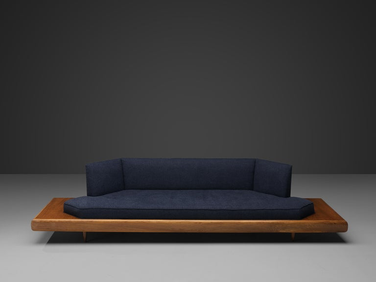 Adrian Pearsall, sofa model '2006S', blue fabric, walnut, United States, 1960s.  Classic, soft shaped sofa has a unique feel and although it is modest and simplistic it also shows soft, delicate lines and shapes. The walnut frame that extends past