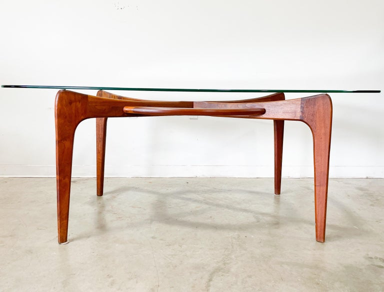 Vintage Mid-Century Modern dining table designed by Adrian Pearsall for his company Craft Associates in the 1960s. Beautifully sculpted solid walnut frame and distinctive boat shaped top. Frame has gorgeous wood grain and is very sturdy. Top is in