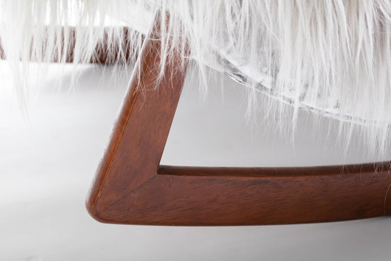 Get cozy in this super luxurious Adrian Pearsall style rocking chaise expertly restored to be a show stopper in any beautiful room. The natural curves are sculptural and alluring; hand selected long, silky Mongolian goat hides are soft and inviting.