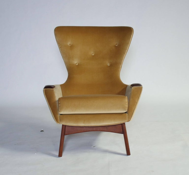 Adrian Pearsall wing chair for Craft Associates model 2231-C and matching ottoman. All newly upholstered in camel velvet and refinished walnut.