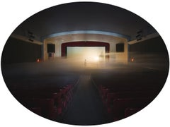The Theater, Mysterious Photograph of Figure on Stage in Dark, Foggy Auditorium