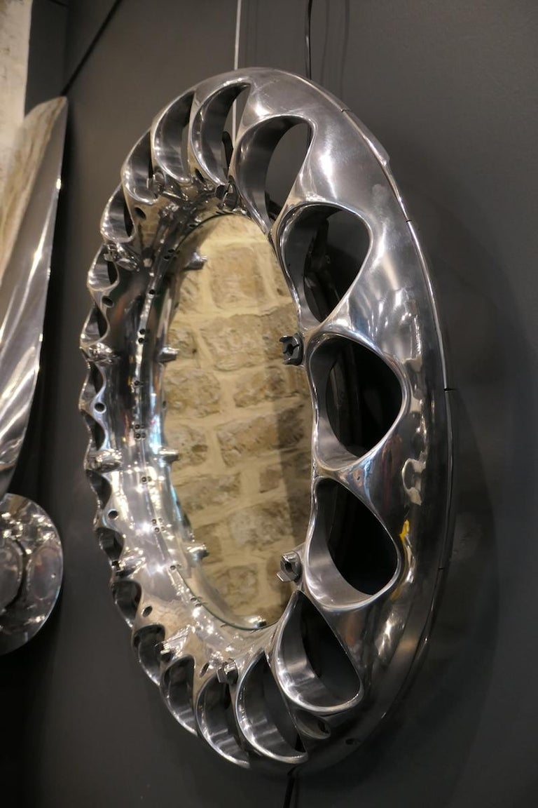A mirror made from a reactor part of an ATAR 9C manufactured by SCNEMA made of aluminum alloy. This part is the crown of the ATAR 9C combustion chamber injectors. This reactor was mounted on the legendary aircraft manufactured by Dassault: The