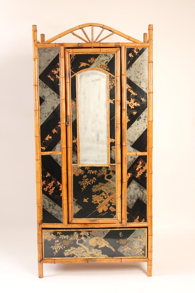 Aesthetic Movement bamboo armoire with chinoiserie style decorations, circa 1930s. Lacquer has a high gloss finish.