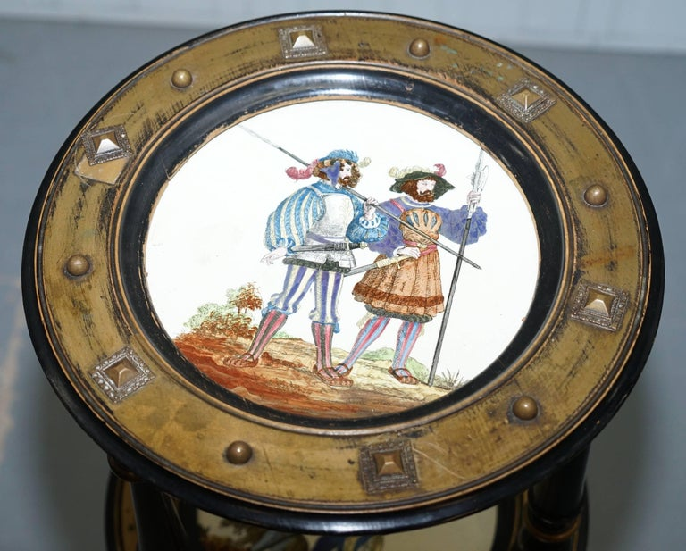 We are delighted to offer for sale this stunning antique Aesthetic movement early 19th century three tired stand with hand-painted plates depicting military scenes.