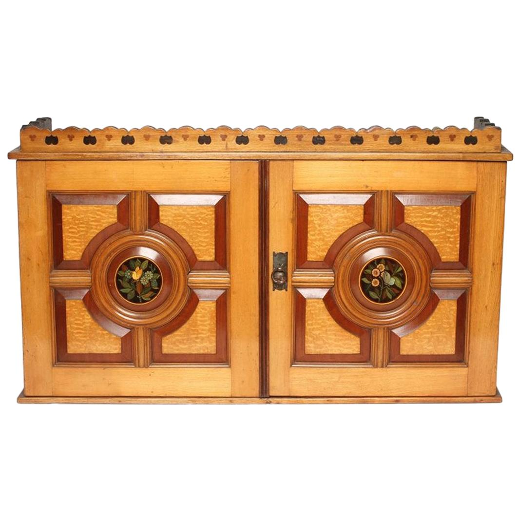 Aesthetic Movement Wall Cabinet with Painted Floral Roundel, Stamped Pomegranate