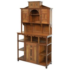 Aesthetic Movement Walnut Cabinet of Architectural Form with Carved Floral Decor