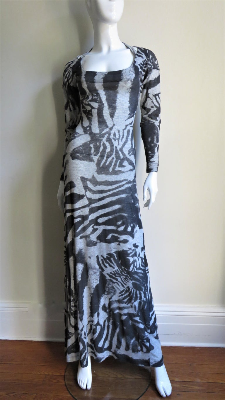 A fabulous bodycon dress from Alexander McQueen in a cotton knit with an abstract pattern in shades of grey.  It is fitted to the hips then flares gently to the hem, slightly more so in the back.  It has long sleeves, a scoop neck in the front and a