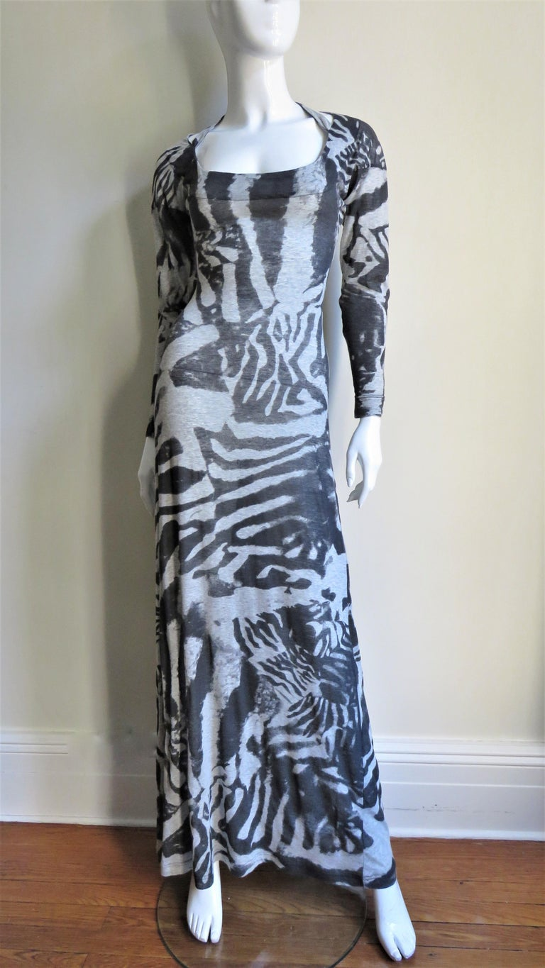 A fabulous bodycon dress from Alexander McQueen in a cotton knit with an abstract pattern in shades of grey.  It is fitted to the hips then flares gently to the hem, slightly fuller in the back.  It has long sleeves, a scoop neck in the front and a