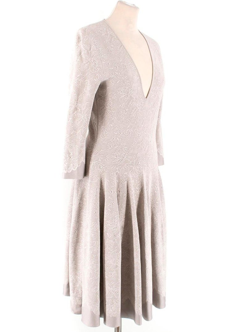 Alexander McQueen Grey Floral Dress  -Grey dress with white lace overlay -Long sleeves -V neck -Fitted bodice with flared skirt  Please note, these items are pre-owned and may show signs of being stored even when unworn and unused. This is reflected