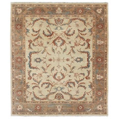 Afghanistan Made Rug in Muted Earthy Tones of Brown, Taupe, Blue, and Coral