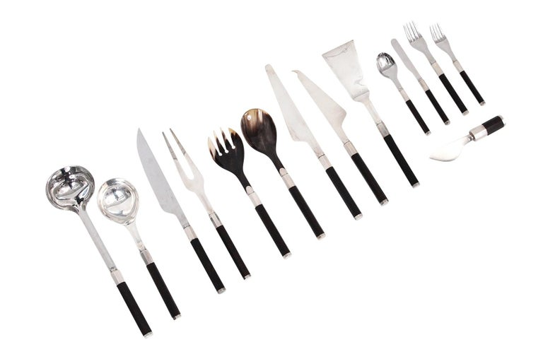 Rare and extensive grouping of 14 pieces of flatware designed by Afra and Tobia Scarpa for San Lorenzo studio, circa 1975. This pattern is executed with exotic wooden handles, sterling, and Horn. Crafted by master silversmith Ciro Cacchione. San