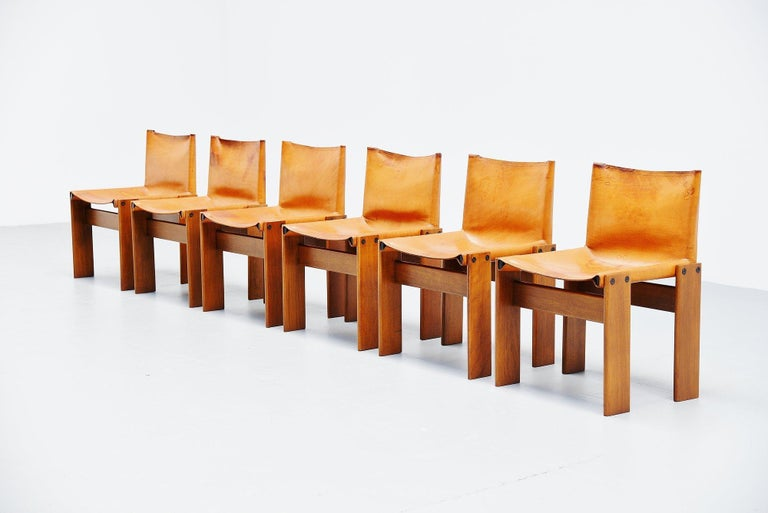 Spectacular set of 6 'Monk' chairs designed by Afra e Tobia Scarpa and manufactured by Molteni, Italy 1974. This is for a set of 6 chairs with solid walnut wooden frames and beautiful patinated natural leather seats. These chairs look really amazing