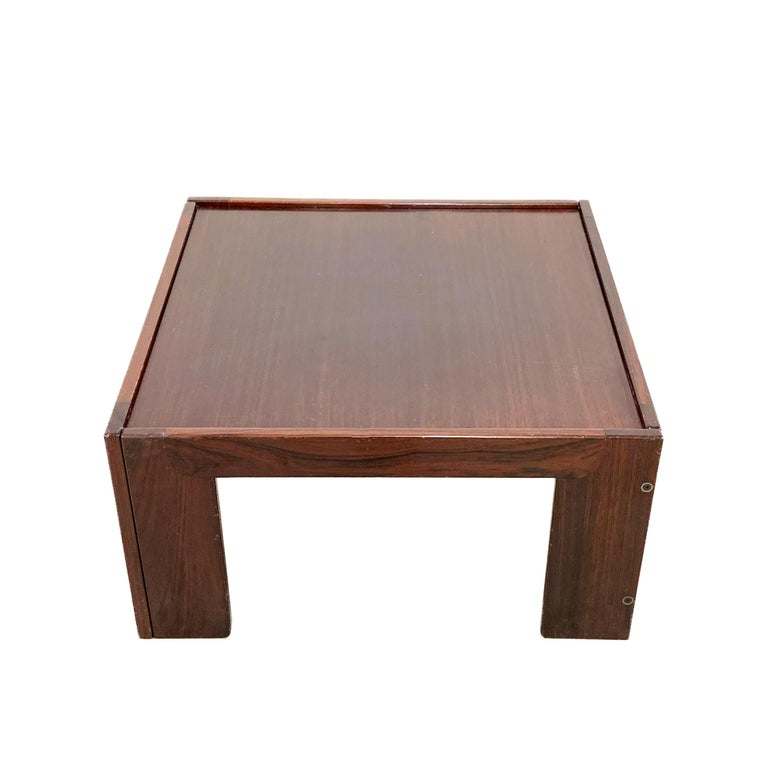 Cassina, coffee table (Afra & Tobia Scarpa, 1965) Square table (75 x 75 x 39 cm) in rosewood designed by Afra & Tobia Scarpa for Cassina in 1965. Removable rosewood top. Some light scratches and signs of use. Easily removable and remountable for