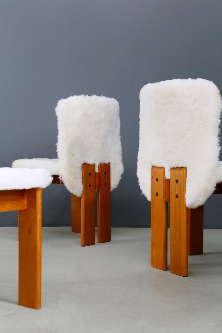 Chairs of Afra and Tobia Shoe from the 1970s. Each chair has been re-lined in real fur. The peculiarity of the seat in addition to its fur upholstery is the line of the wooden legs. Clean and essential lines typical of the designers Afra and Tobia