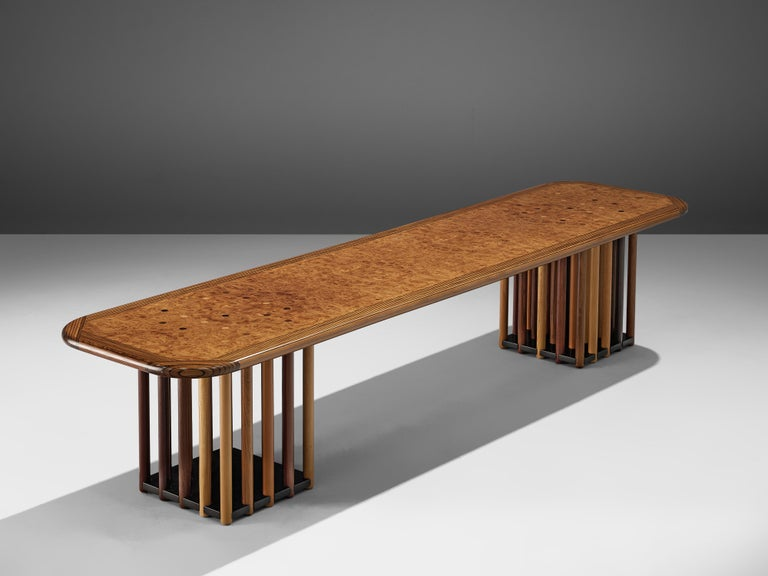 Afra and Tobia Scarpa, 'Artona' coffee table, maple burl, birch, beech, oak and fruitwood, Italy, circa 1975.  Every detail about this design is extraordinary. Thelong table features two feet that exist out of circular rods. The different types