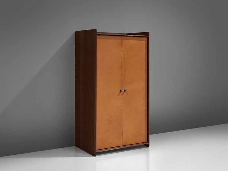 Afra & Tobia Scarpa, 'Artona' cabinet, walnut and cognac leather, Italy, circa 1975  This wardrobe with leather front is designed as part of the Artona line by The Artona line by the Scarpa duo was in fact the first line ever produced by Maxalto,