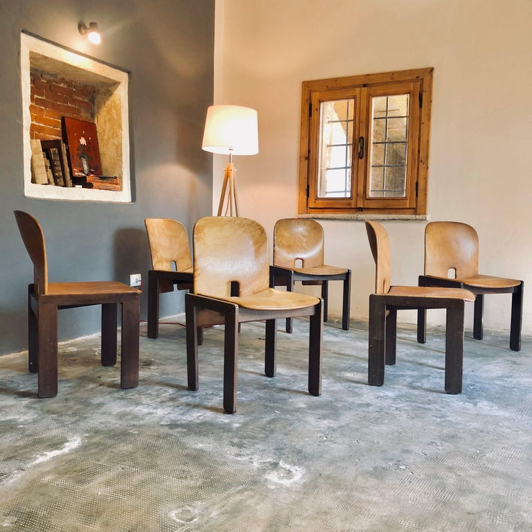 """Set of 6 dining chairs """"121"""" by Afra & Tobia Scarpa for Cassina. Original cognac leather upholstery. This set is a rare ones as it is the first series production, in 1965.   General conditions are good. Leather is good even if it shows time"""