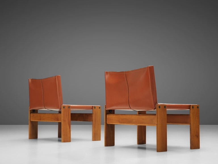 Afra & Tobia Scarpa for Molteni, pair of 'monk' lounge chairs, beech and cognac leather, Italy, 1970s  This version of the 'Monk' chair by Afra & Tobia Scarpa is a lower model with a wider seat.The wonderfully cognac leather forms a striking