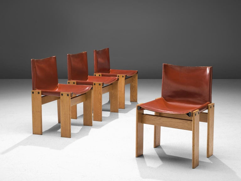 Afra & Tobia Scarpa, set of four 'Monk' dining chairs, patinated teak and red leather, Italy, 1974.  The wonderfully red leather forms a striking combination with the blond wood. Interesting is the 'flat' shape of this chair where the designer has