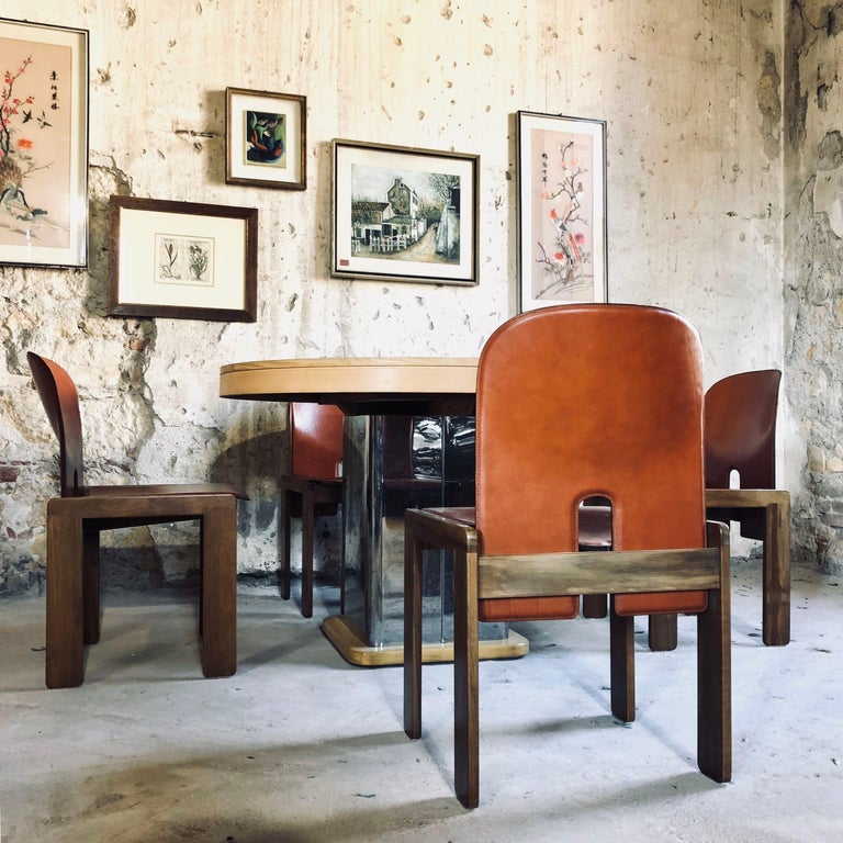 """A set of four """"121"""" chairs by Afra & Tobia Scarpa. Red leather original upholstery. The model 121 chair was produced by Cassina's employees molding brown leather covered plywood and a base of Italian walnut. The chair is broken down to its basic"""