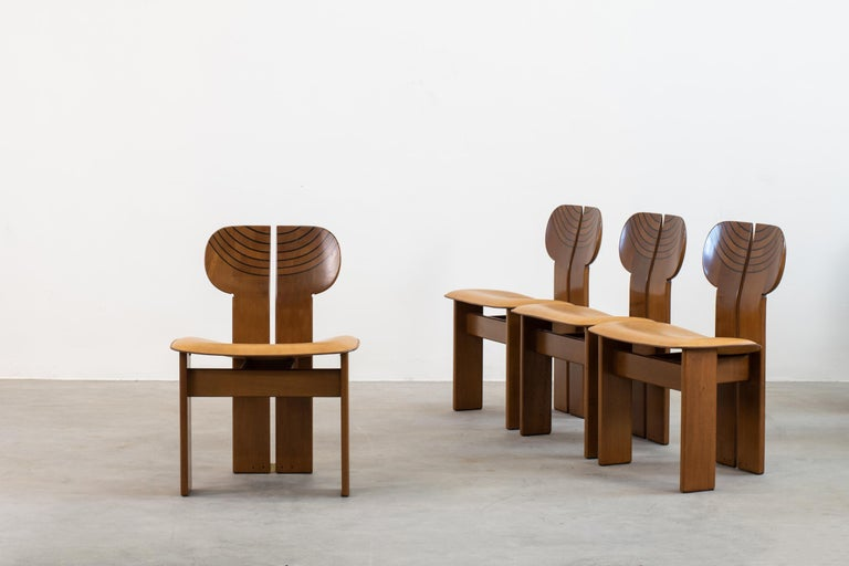 A beautiful set of four chairs designed by Afra & Tobia Scarpa in 1970, model Africa produced by Maxalto, Italy  These chairs present a structure in walnut, burl, black leather, and brass. they are part of the Artona series the first collection