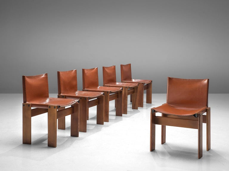 Afra & Tobia Scarpa, set of six monk dining chairs, wood and patinated cognac leather, Italy, 1974.  The wonderfully dark red leather forms a striking combination with the walnut wood. Interesting is the 'flat' shape of this chair where the