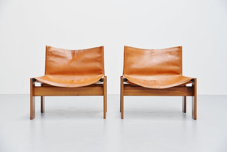 Super rare low 'Monk' lounge chairs designed by Afra e Tobia Scarpa and manufactured by Molteni, Italy 1974. These chairs have solid walnut legs and natural leather seats. I have never seen these low lounge chairs and also cannot find them on the