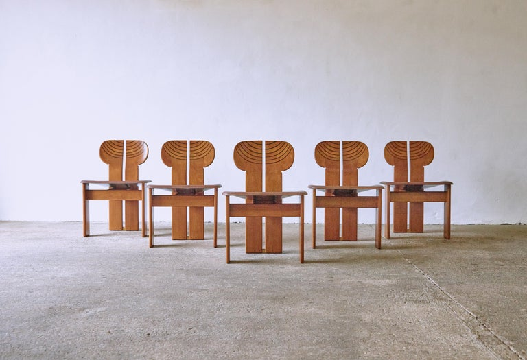 A superb set of five Africa chairs with matching dining table designed by Afra & Tobia Scarpa in the 1970s, and produced by Maxalto, Italy. Walnut, burl, black leather and brass. Good original condition with minor age related signs of use and wear.