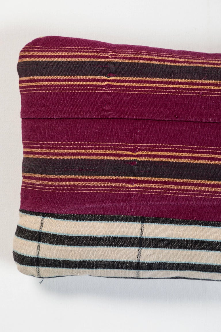 Pat McGann Workshop Double-sided pillow made using vintage Ashante textile. Handwoven in Nigeria by the Yoruba Tribe. Long strips of cotton hand woven on narrow backstrap looms. Invisible zipper closure and feather and down fill.