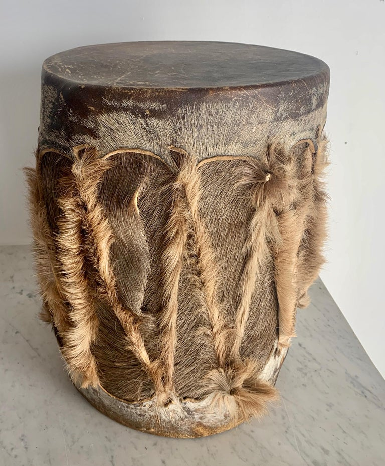African hide drum, while the drum works it is also a great decorative piece for any room that needs a bit of texture or ethnicity, a wonderful piece also for the Childs room.