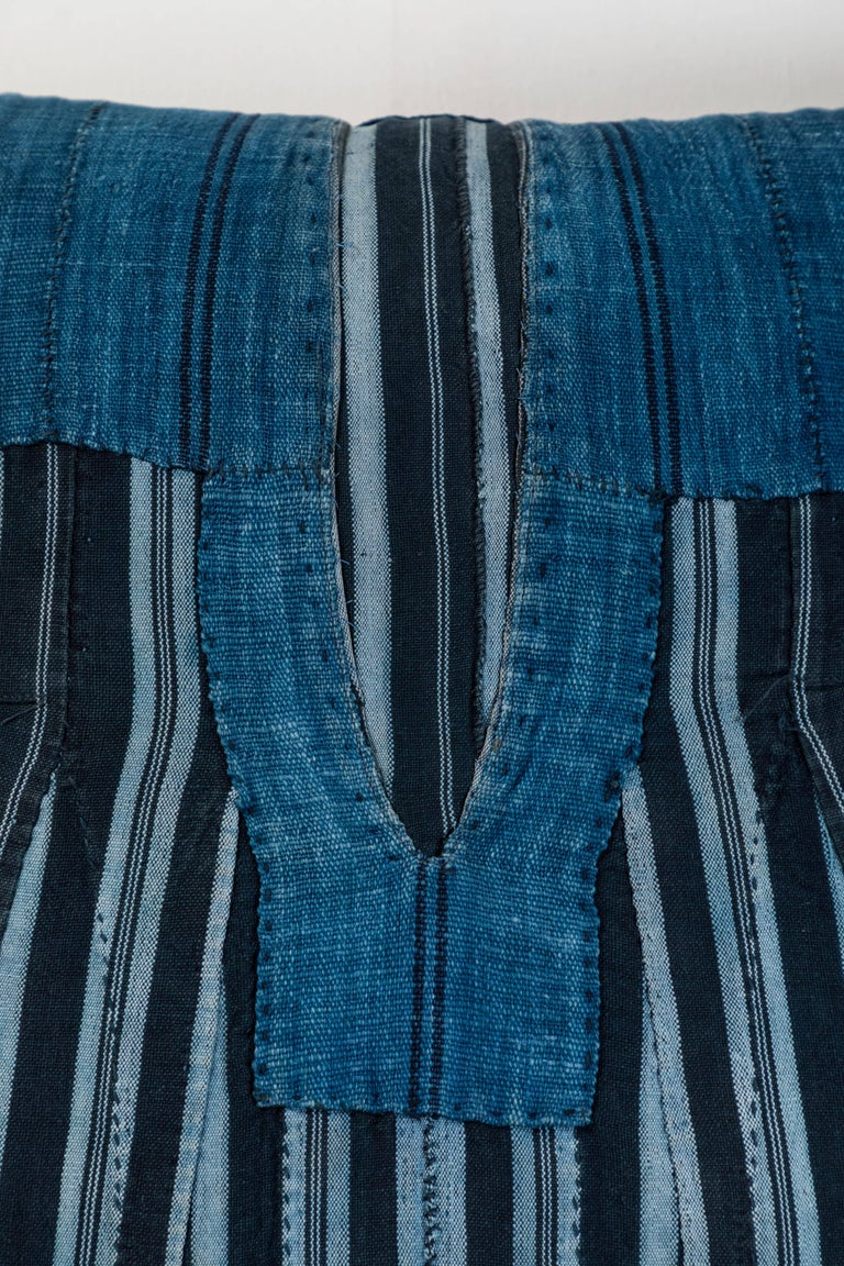Pat McGann Workshop Pillow made using vintage Ashante textile. Handwoven in Nigeria by the Yoruba Tribe. Long strips of cotton hand woven on narrow backstrap looms.  Blue linen back, invisible zipper closure and feather and down fill.