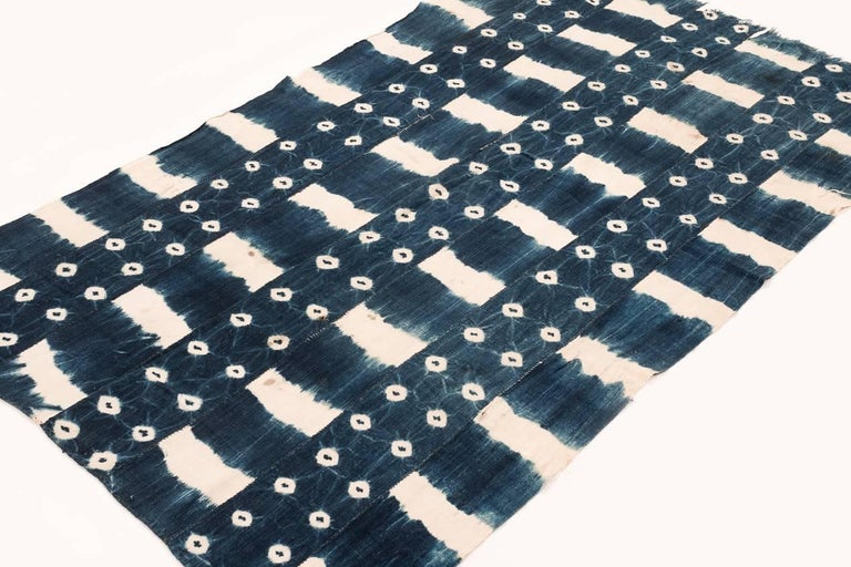 This textile was handwoven from very soft cotton and dyed with natural indigo, which gives it that rich, sparkly blue. Perfect as a wrap for the beach or as a small throw on the sofa. Measures: 3' x 5'3