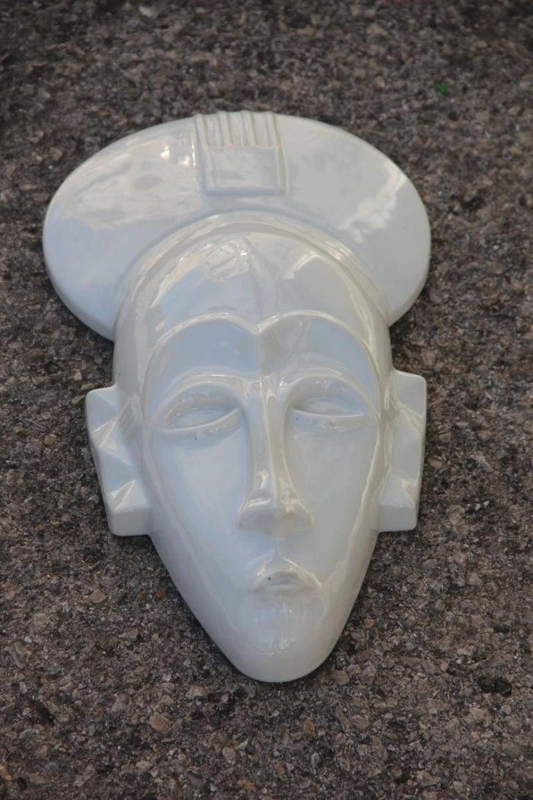 African mask in hard porcelain glossy French design 2010 Jean Dange Paris White.