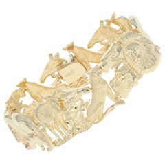 African Safari Panel Bracelet, 10 Karat Yellow Gold Sapphire Cabochon .60 Carat