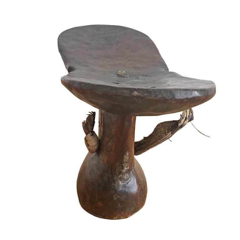 An African tribal headrest carved out of one section of wood from the Konso Tribe in Shankila, Ethiopia. The Konso, also known as the Xonsita, are a Lowland East Cushitic-speaking ethnic group primarily inhabiting south-central Ethiopia. This is an