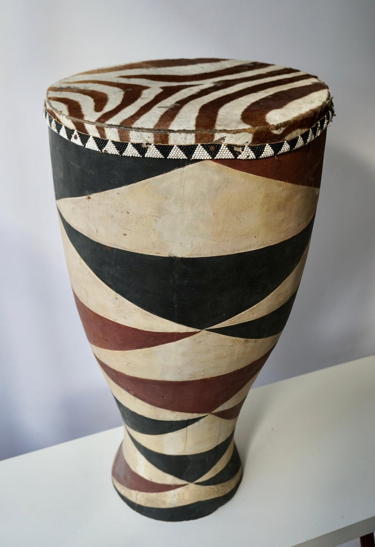 African hide drum table, hand carved and painted base with leather zebra roping. A handsome side or coffee table for rooms from modern to Ethnic. The perfect way to add, not only character but dimension and texture. Congo, Rwanda,