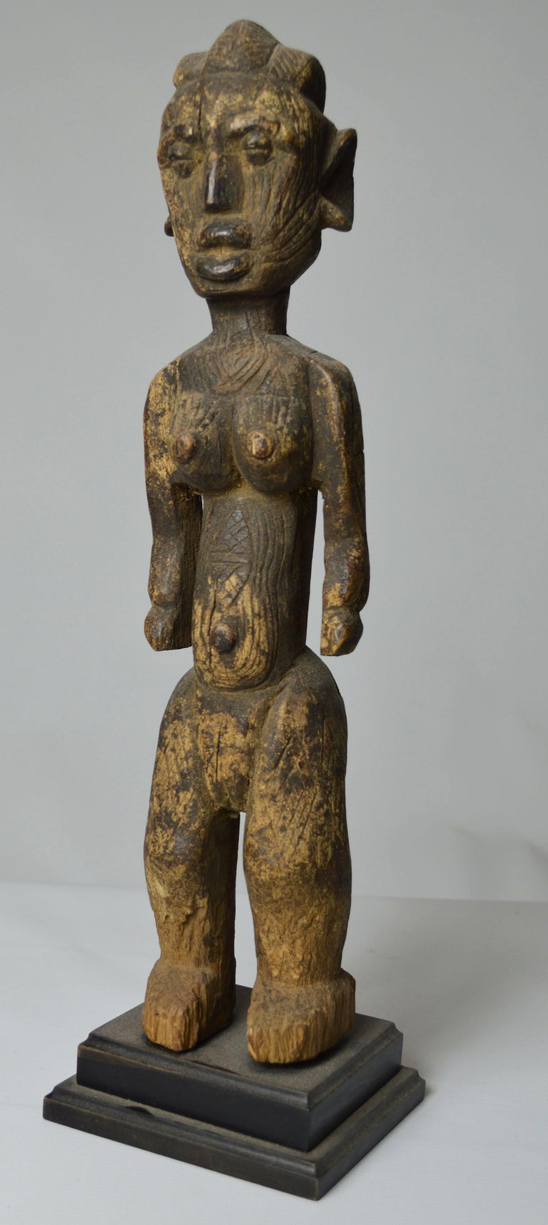 A rare Himbi fetish figure Benue river Nigeria  This is a rare Himbi fetish from the Benue river area of Nigeria  The Himbi are a sub tribe of the larger Afo tribe who inhabit parts of the remote Benue river area in Nigeria  The powerful standing