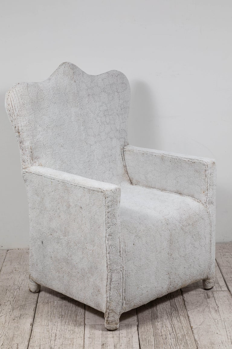 Rare African beaded chair from Nigeria. Meticulously assembled by hand in Nigeria using all white beads over a canvas and wood frame. Each chair is one-of-a-kind and exceptionally un-common.