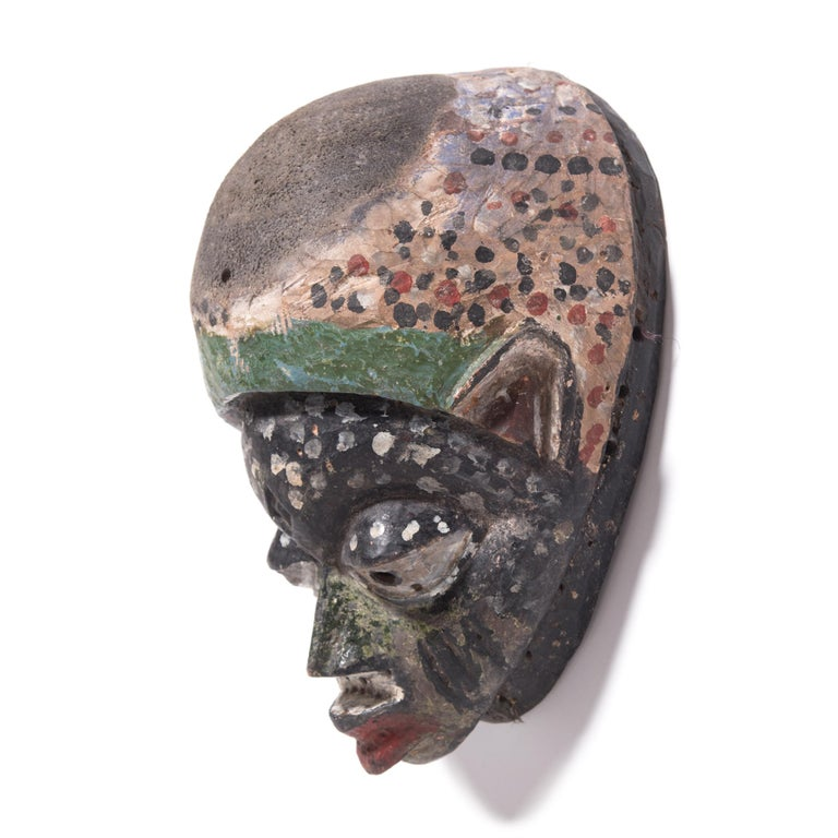 This painted mask was created by the Yoruba People of western Nigeria, and was worn during a tradition known as Gelede. A blend of ritual and artistic spectacle, Gelede pays homage to the women of their Community, understood to possess spiritual