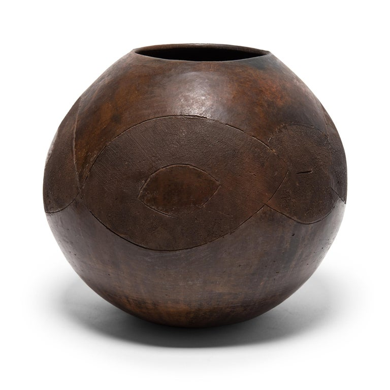 The Zulu people of South Africa create ceramic works of unrivaled balance and weightlessness. This is particularly apparent in the standardized form of the ukhamba, a communal vessel used for drinking sorghum beer. Carrying into the present notions