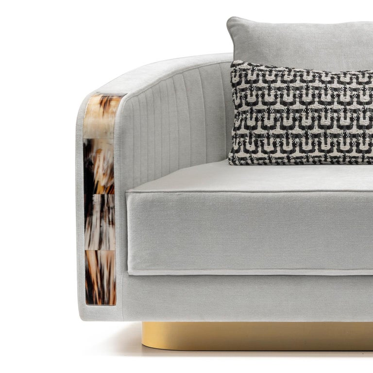 Distinguished by gentle lines and plush materials, Afrodite sofa will imbue your decor scheme with sophistication and class. Curved accents in Corno Italiano create an exquisite textural contrast with the upholstery, quilted with a ribbed motif on
