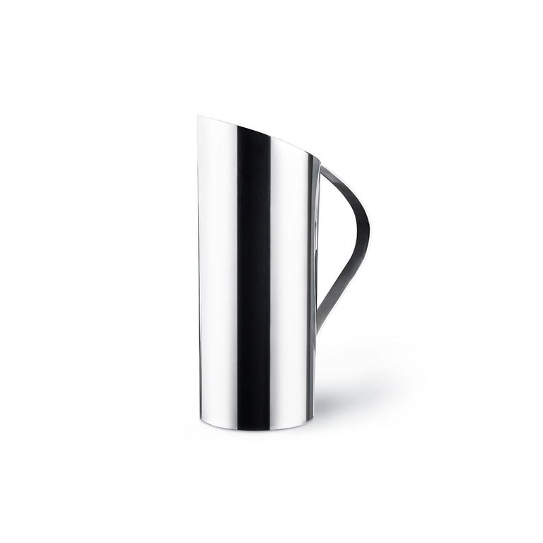 Afroditi is a silver plated carafe designed by Afroditi Krassa. The mirror polished finishing plays with the light of the room that emphasizes the elegant curves and the timeless silhouette. Afroditi is also available with a silver plated finishing.