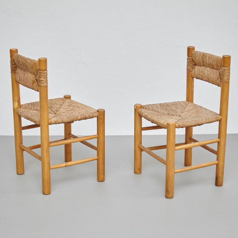 Set of 2 Mid-Century Modern wood rattan French chairs, circa 1950. By unknown manufacturer, France.  In original condition, with minor wear consistent with age and use, preserving a beautiful patina.  Materials: Wood Rattan  Dimensions: D